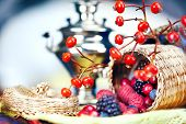 samovar and a basket with berries
