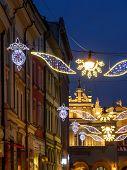 Outdoor street christmas illumination at night, Krakow, Poland