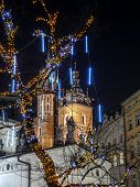 Closeup of Saint Mary Church towers by night, Main Market Square, Krakow, Poland