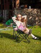 Cute Girl In Sunglasse Sunbathing At Backyard