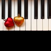 Christmas ornaments on piano keys