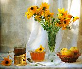 Still-life with juicy fresh pears both fragrant honey and fresh tea and a bright bouquet