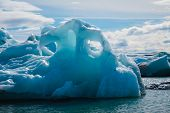 picture of iceberg  - floating icebergs in glacier lagoon in Iceland - JPG