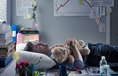 Office Worker Sleeping At Work With Teddy Bear