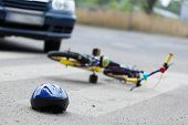 pic of accident victim  - A small bike and a helmet lying on the road - JPG
