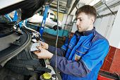 Car servicing, replacing air filter maintenance at auto repair shop