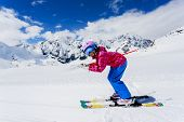 Skiing, winter sport  - skier on mountainside