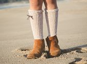 Detail Of Little Girl Boots On The Beach