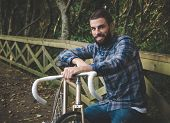 Hipster Man With A Bike And Smiling