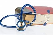 stock photo of auscultation  - book and stethoscope - JPG