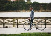 Hipster Man Walking on A Boardwalk