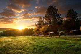 stock photo of farm landscape  - Picturesque landscape fenced ranch at sunrise  - JPG