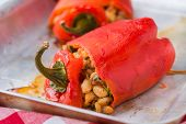 stock photo of trays  - Red pepper stuffed with white beans on baking tray selective focus - JPG