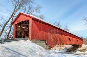 picture of covered bridge  - The historic red Oakalla Covered Bridge crosses Big Walnut Creek in rural Putnam County Indiana - JPG