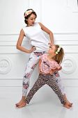 picture of yell  - Young happy mother and four years old daughter laughing together smiling yelling screaming in the room on a white background - JPG