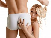 stock photo of ass  - Image of hot blonde posing with sexy guy - JPG