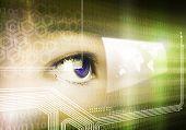 stock photo of human eye  - Close up of human eye on digital binary background - JPG