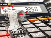 image of receipt  - Shopping cart on calculator and receipt - JPG