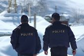 Two Policemen Patrolling In The Winter - Georgia