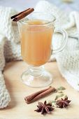 picture of heartwarming  - The glass of warming drink with spices and scarf on the background - JPG