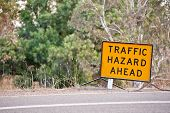 stock photo of hazardous  - Yellow traffic hazard sign on the side of a highway - JPG