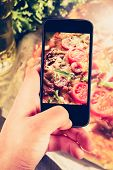 picture of take out pizza  - Using smartphones to take photos of pizza with instagram style filter - JPG