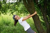 picture of teenage girl  - smiling teenage girl under the plum tree enjoying over green natural background - JPG