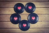 stock photo of jukebox  - Vinyl records with red love hearts on a wooden surface - JPG