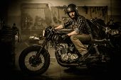 foto of rockabilly  - Rider and his vintage style cafe - JPG