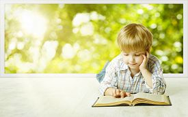 stock photo of child development  - Young Child Boy Reading Book Children Early Development Small Kid School Education Study and Knowledge Concept - JPG