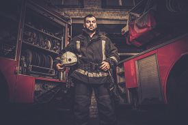 picture of firefighter  - Firefighter near truck with equipment  - JPG