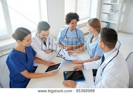 hospital, medical education, health care, people and medicine concept - group of happy doctors with