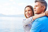 stock photo of amor  - Amorous couple having romantic vacation by the sea - JPG