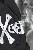stock photo of pirate flag  - Pirate waving flag on a bad day - JPG