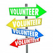 stock photo of charity relief work  - Volunteer word on arrow signs pointing you to different ways or places to donate your time to charity work - JPG