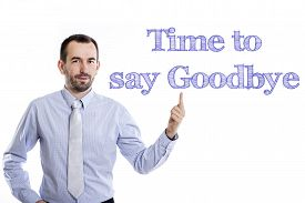 pic of say goodbye  - Time to say goodbye Young businessman with small beard pointing up in blue shirt - JPG