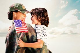 pic of reunited  - Solider reunited with son against blue sky - JPG