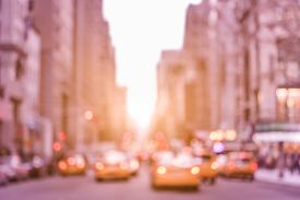 foto of marsala  - Rush hour with defocused yellow taxi cabs and traffic jam on 5th avenue in Manhattan downtown at sunset  - JPG