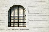foto of ou  - Close-up or a segment of a wall with a gated window which looks out to nothing but another brick wall. White washed brick wall with a iron gated window looking ou at a white washed brick wall  - JPG