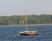 pic of yardarm  - Sail Boat anchored at the mouth of a bay