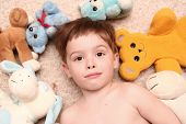 The Boy Lays Among Soft Toys poster