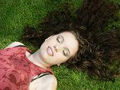 Beautiful Girl Sleeping On The Grass poster