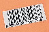 barcode on orange background closeup