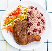 foto of jerk  - Caribbean style jerk chicken served with rice mixed with red kidney beans - JPG
