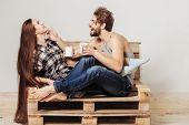 Young Couple On Wooden Sofa poster