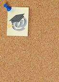 note with online graduation symbol posted on corkboard