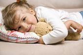 stock photo of night gown  - Little girl with bear on sofa - JPG