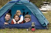 Happy family camping in tent