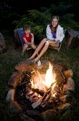 image of family vacations  - Two girls roasting marshmallows - JPG