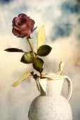 red rose in a vase in soft pastel tonality